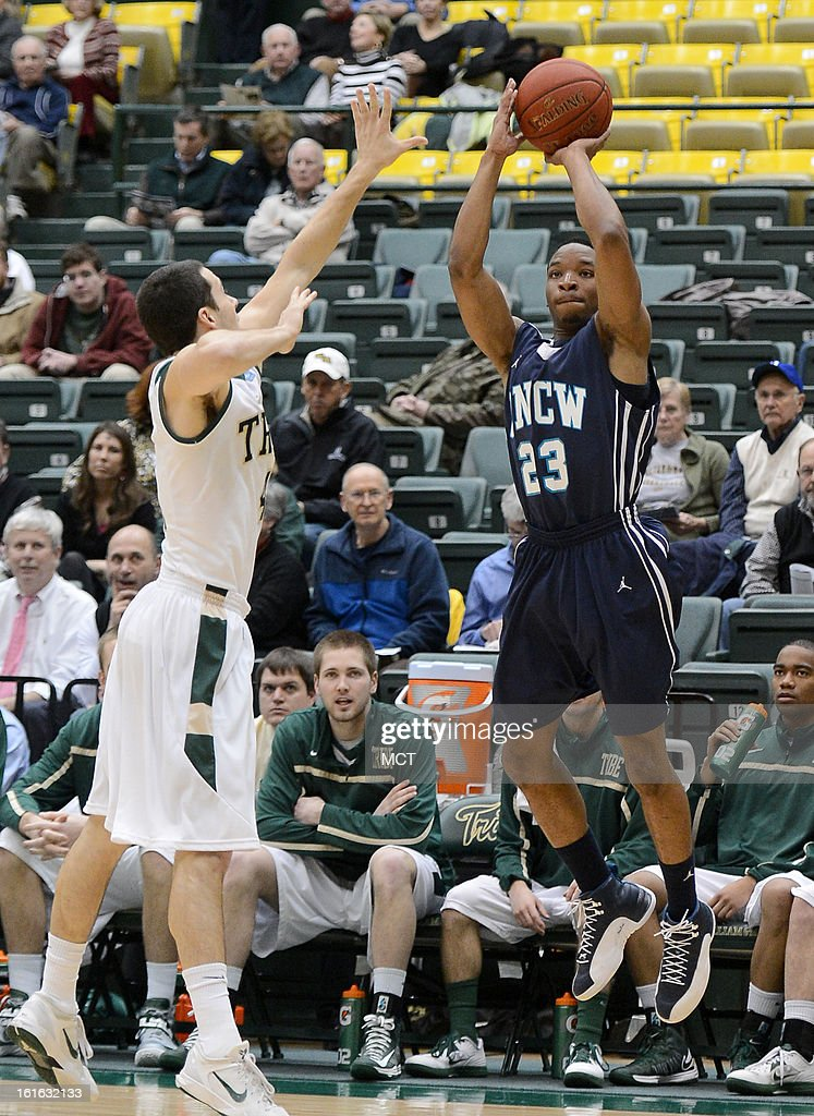 North Carolina-Wilmington guard Craig Ponder (23) hits a three-point shot over William & Mary guard Matt Rum (4) in the first half at Kaplan Arena in Williamsburg, Virginia, Wednesday, February 13, 2013.