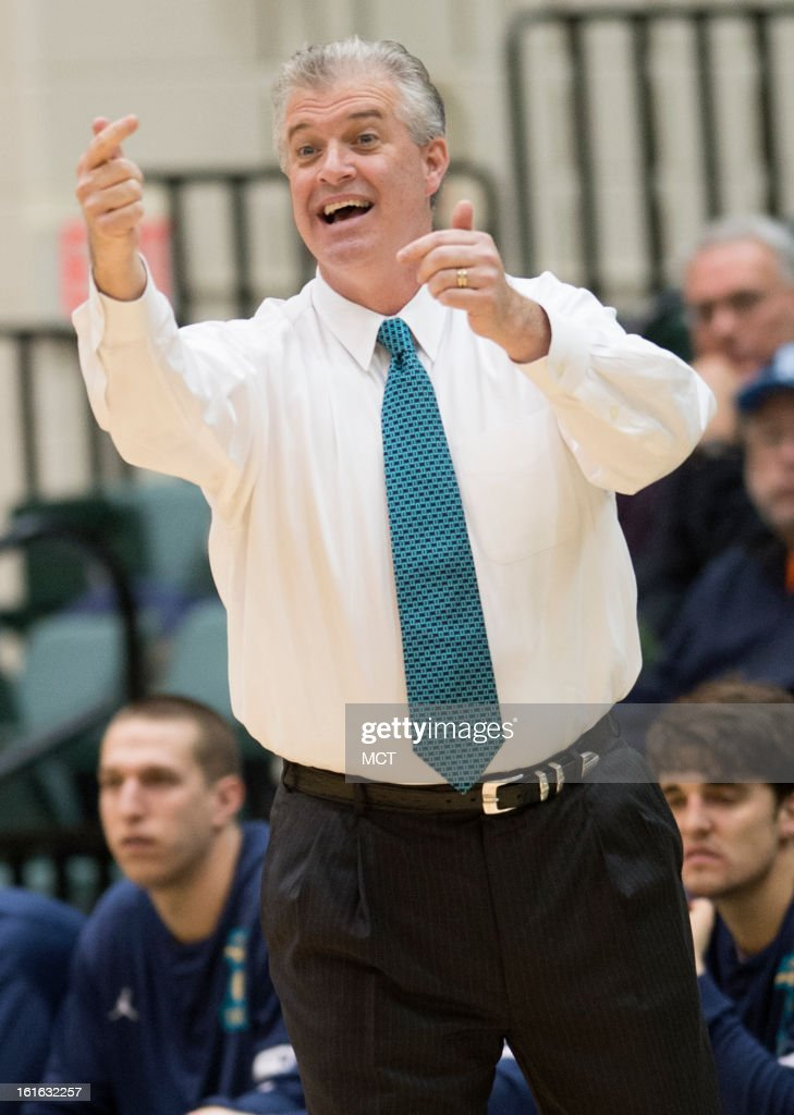 North Carolina-Wilmington head coach Buzz Peterson directs his players in the first half against William & Mary at Kaplan Arena in Williamsburg, Virginia, Wednesday, February 13, 2013.