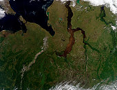 August 1, 2009 - A clear day over north central Russia. In the top left corner, you can see the bottom part of the Novaya Zemlya archipelago and the Kara Strait, which separates it from mainland Russi