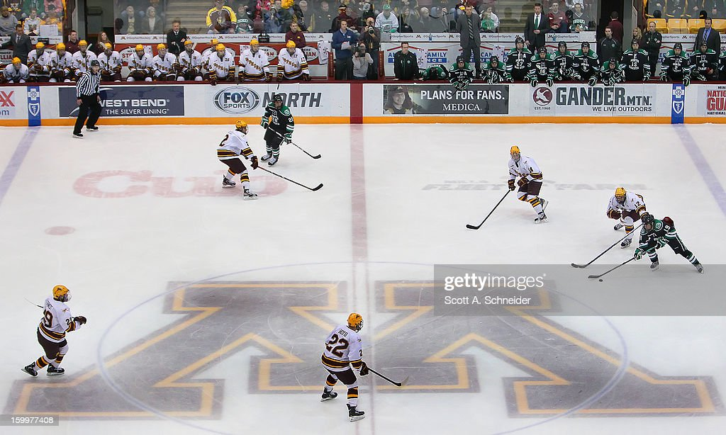 North Dakota and Minnesota play their last game against each other as members of the Western Collegiate Hockey Associtation (WCHA) January 19, 2013 at Mariucci Arena in Minneapolis, Minnesota. Both teams move to new divisions next year.