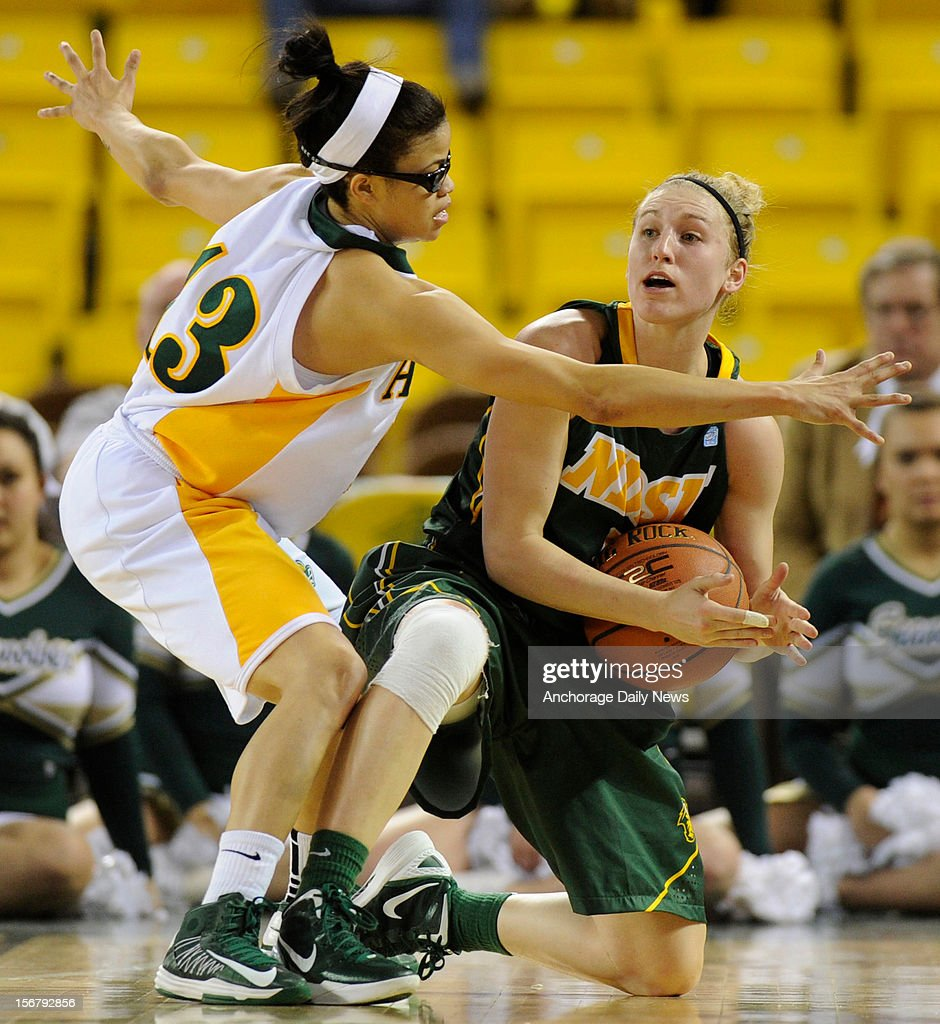 North Dakota State's Katie Birkel calls for a timeout as UAA's Sasha King defends. UAA defeated North Dakota State 73-47 in the opening round of the 2012 Women's Great Alaska Shootout tournament on November 20, 2012 in Anchorage, Alaska.