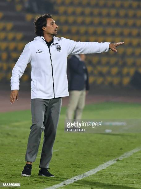 North East United FCs head coach Joao De Deus reacts during the Indian Super League football match between Northeast United FC and Bengaluru FC at...
