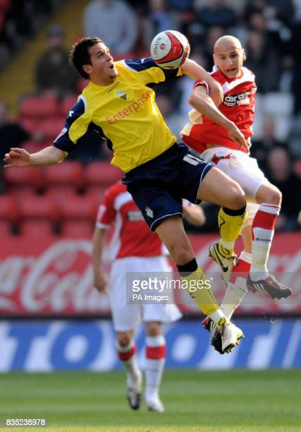 North End's Darren Carter and Charlton Athletic's Jonjo Shelvey battle for a ball in the air during the CocaCola Championship match at The Valley...
