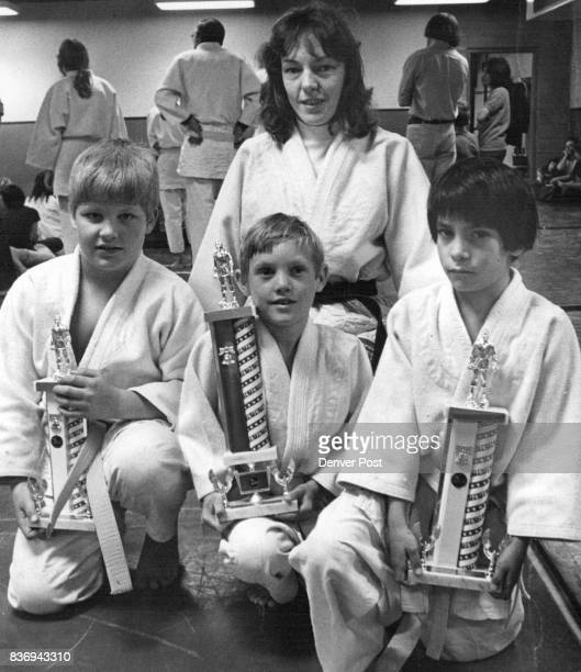 North Jeffco Judo Club Members Win Invitational Tournament Honors Fred Malone left Tommy Kubic Charles Quintana display trophies Instructor Terry...