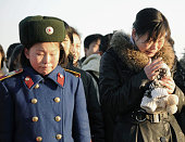 PYONGYANG North Korea Citizens cry on Mansu Hill in central Pyongyang on Dec 19 following news that North Korean leader Kim Jong Il has died