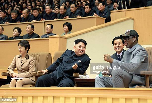 PYONGYANG North Korea Former US basketball star Dennis Rodman and North Korean leader Kim Jong Un chat while watching an exhibition basketball game...