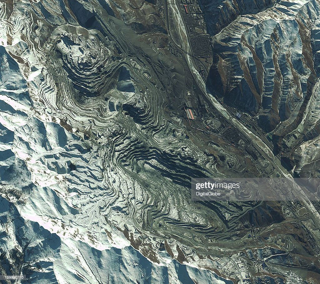 North Korea hopes to increase output at the Musan Iron Ore Mine by 120 percent. The mine currently has two operational mine pits and sits along a rail line near the Chinese border, as seen in this satellite image from January 7, 2013. The mine has the potential to produce 1.5 million tonnes of ore a year if the North Koreans can operate it at its former capacity under Tianchi Industry and Trade.