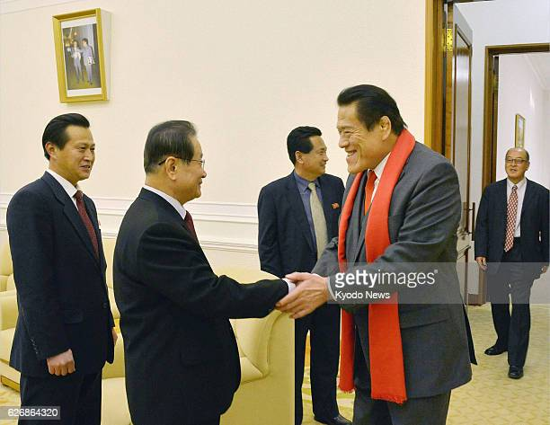 PYONGYANG North Korea Japanese opposition lawmaker Antonio Inoki is greeted by Kim Yong Il director of the International Department of the Workers'...