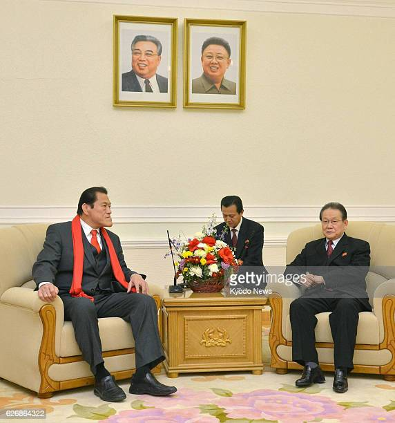 PYONGYANG North Korea Japanese opposition lawmaker Antonio Inoki talks with Kim Yong Il director of the International Department of the Workers'...