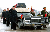 PYONGYANG North Korea Kim Jong Un son of the late North Korean leader Kim Jong Il and his successor salutes beside the hearse carrying the coffin of...