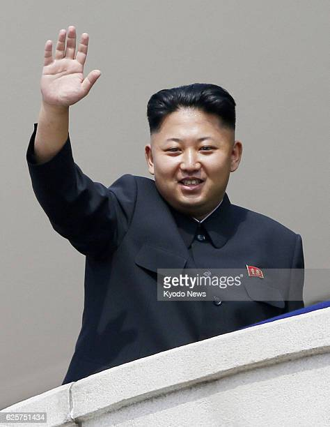 PYONGYANG North Korea North Korean leader Kim Jong Un waves at the crowd after reviewing a parade of militia forces at Kim Il Sung Square in...
