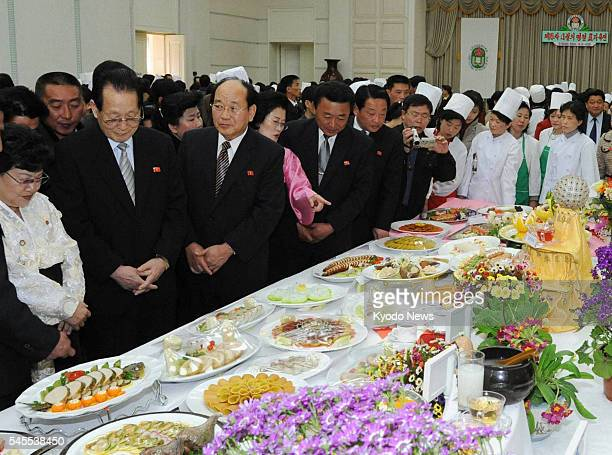 PYONGYANG North Korea North Korean senior government officials check out dishes served at the 16th April Holiday Food Festival in Pyongyang on April...