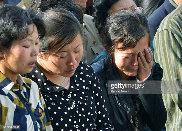 PYONGYANG North Korea North Korean women listen as an official in charge of the construction of an apartment building apologizes to bereaved families...