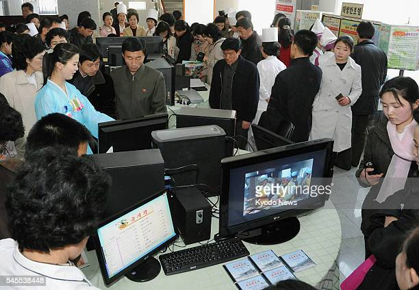 PYONGYANG North Korea People gather around computer screens displayed at the site of the 16th April Holiday Food Festival in Pyongyang on April 4...