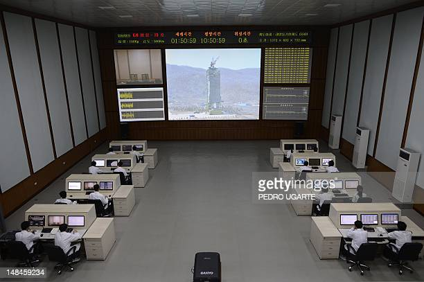 North Korea technicians watch live images of the rocket Unah3 at the satellite control room of the space center on the outskirts of Pyongyang on...