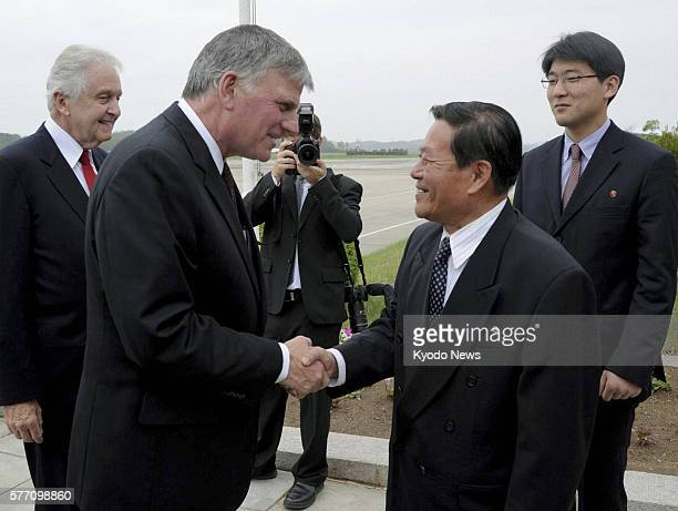 PYONGYANG North Korea US evangelist Franklin Graham and Ri Gun director of the US Affairs Department at North Korea's Foreign Ministry shake hands as...