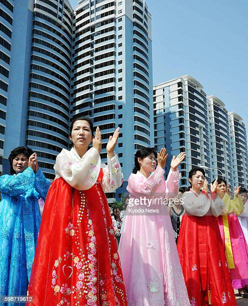 PYONGYANG North Korea Women applaud during a ceremony on June 20 to mark the completion of redevelopment of the Mansudae area in central Pyongyang...