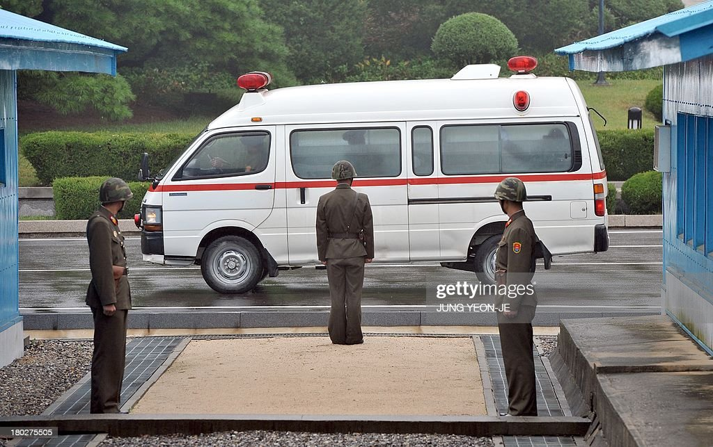 A North Korean ambulance carrying a coffin containing the body of a North Korean soldier, who was found dead in the Han river near the border in July, during a repatriation ceremony at the truce village of Panmunjom in the Demilitarized zone dividing the two Koreas on September 11, 2013. The ceremony was supervised by United Nations officials who have been monitoring the truce since the 1950-53 Korean War.