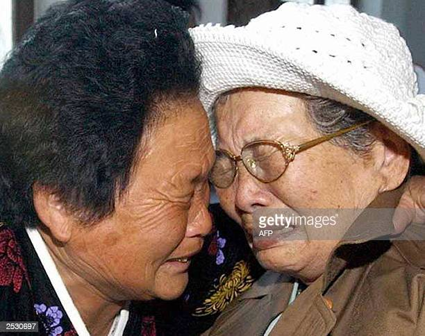 North Korean and South Korean relatives cry during their first meeting at Kumgang Mountain in North Korea 23 September 2003 Four hundred and...