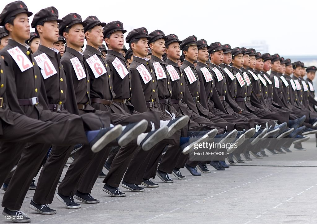 North Korean Army Parade in Pyongyang, North Korea - North Korea is the most militarised country in the world. According to the US State Department, North Korea has the 4th largest military in the world, at an estimated 1.2 million armed personnel for 23 millions north koreans. Even if many think NK has nuclear bomb, the guns, cars, military equipment seems to come from the 50's... The Korean People's Army is the military of North Korea. Kim Jong Il is the Supreme Commander of the Korean People's Army. The famous Bush's Axis of evil includes Iran, Iraq, and North Korea. In NK, every young man stay for 6 years in the Army. It means that for 6 years, he won't have many news from his families because there is no email, mobile and very few private phones in North Korea.
