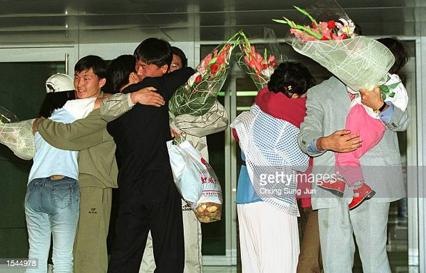 North Korean asylum seekers are welcomed by their relatives who escaped from North Korea last June and live in Seoul upon on their arrival May 23...