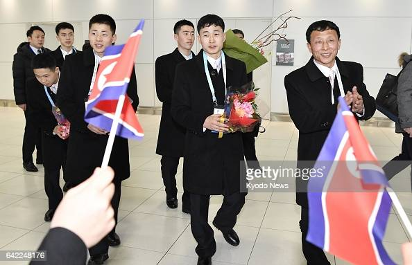 North Korean athletes and accompanying officials are welcomed on Feb 17 at New Chitose Airport on Japan's northernmost main island of Hokkaido They...