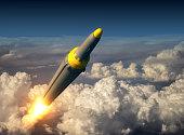 North Korean Ballistic Rocket Over The Clouds. 3D Illustration.