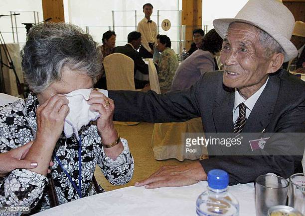 North Korean Chae DuSik comforts his South Korean wife Kang JungSoon who was separated by the 195053 Korea War during a temporary family reunion June...