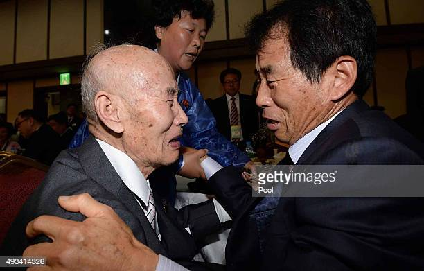 North Korean Chae HoonShik meets with his South Korean son Chae HeeYang during the family reunion after being separated for 60 years on October 20...