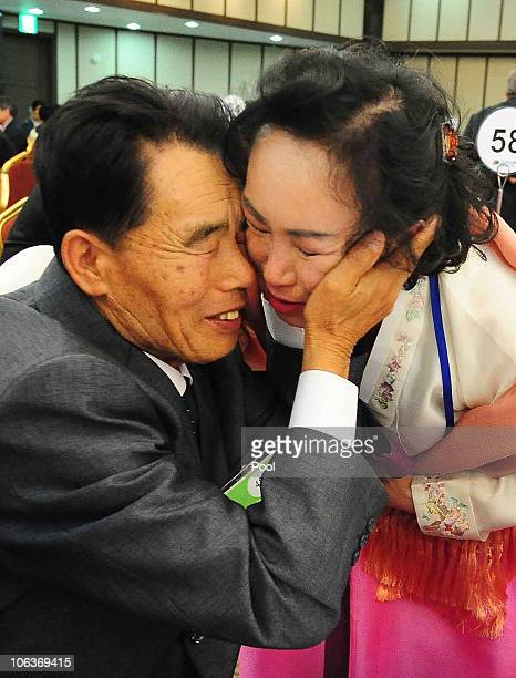 North Korean Chung KiHyung meets his South Korean sister during a family reunion after being separated for 60 years on October 30 2010 in Mount...
