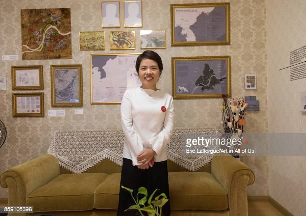 North Korean defector guide Mrs Moon during the exhibition Pyongyang sallim at architecture biennale showing a north Korean apartment replica...