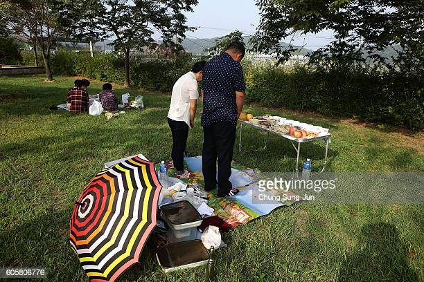North Korean defector Jang YoonNam and Nam SunHee pay respects to their ancestors in North Korea during a ceremony to mark the Chuseok the Korean...