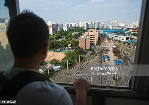 North korean defector joseph park in his former apartment in yangcheong looking at the rail maintenance workshop national capital area seoul South...
