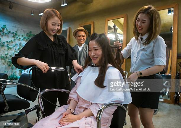 North korean defector joseph park with his south korean fiancee juyeon in a beauty saloon national capital area seoul South Korea on May 31 2016 in...