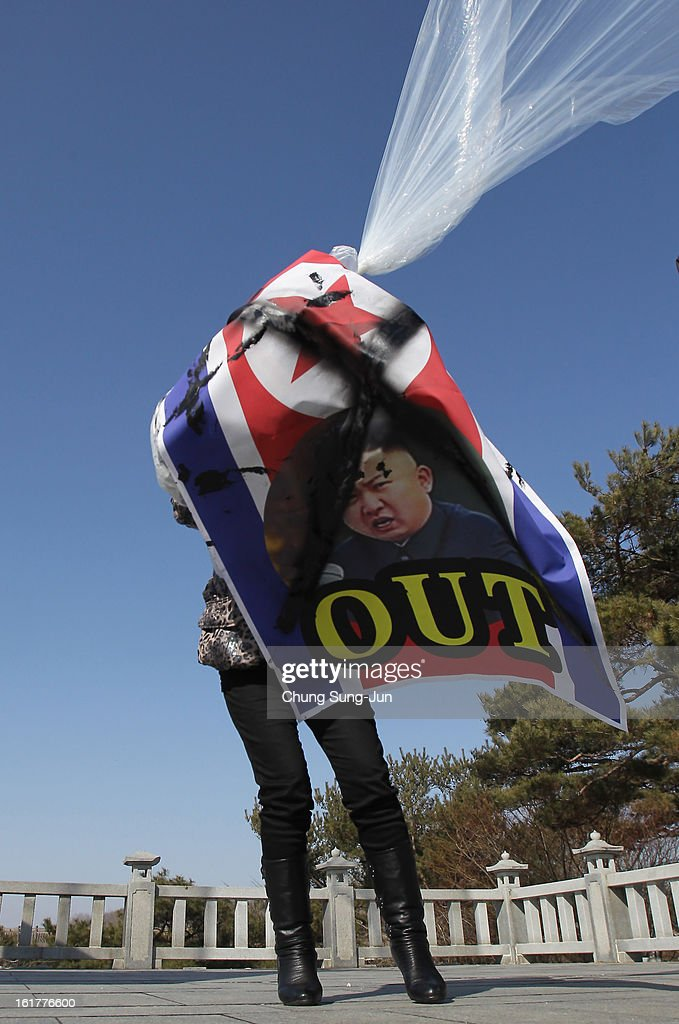 A North Korean defector, now living in South Korea, prepare to release balloons carrying propaganda leaflets denouncing North Korea's nuclear test at Imjingak, near the Demilitarized Zone (DMZ) on February 16, 2013 in Paju, South Korea. February 16 is late leader Kim Jong-Il's birthday and defectors dare to launch the balloons today, to denouce the nuclear test.