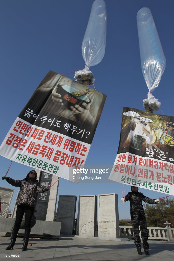 North Korean defectors, now living in South Korea, prepare to release balloons carrying propaganda leaflets denouncing North Korea's nuclear test at Imjingak, near the Demilitarized Zone (DMZ) on February 16, 2013 in Paju, South Korea. February 16 is late leader Kim Jong-Il's birthday and defectors dare to launch the balloons today, to denouce the nuclear test.