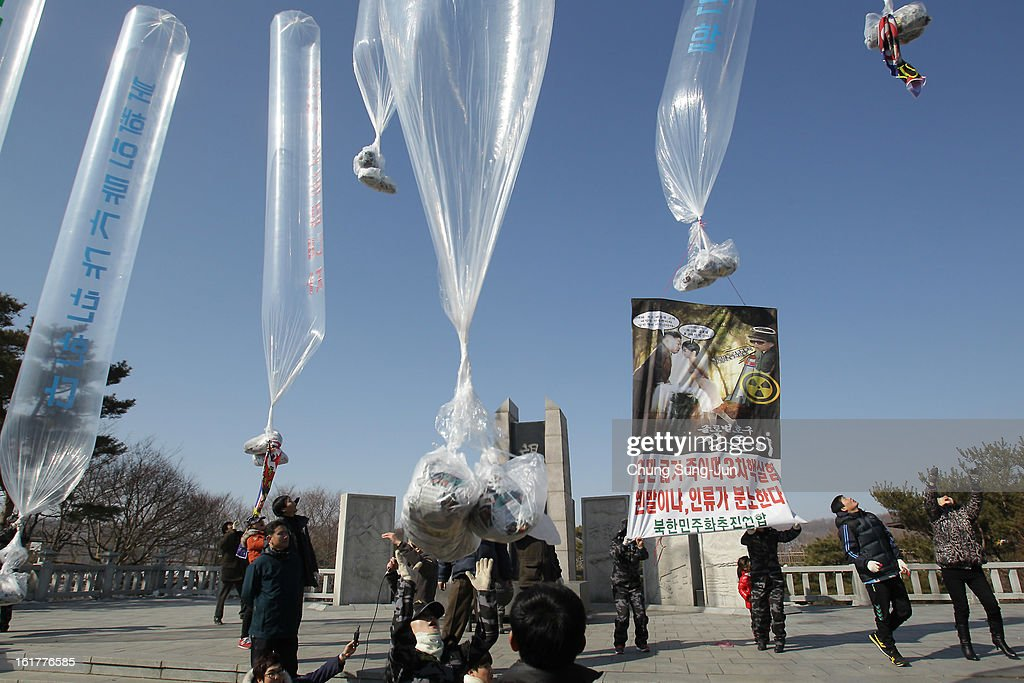 North Korean defectors, now living in South Korea, release balloons carrying propaganda leaflets denouncing North Korea's nuclear test at Imjingak, near the Demilitarized Zone (DMZ) on February 16, 2013 in Paju, South Korea. February 16 is late leader Kim Jong-Il's birthday and defectors dare to launch the balloons today, to denouce the nuclear test.