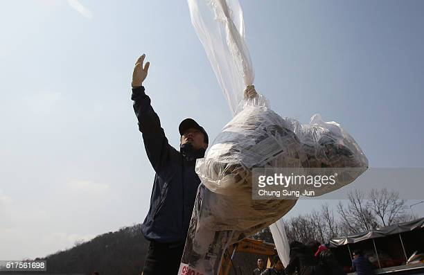 North Korean defectors now living in South Korea release balloons carrying propaganda leaflets denouncing recent North Korea's nuclear test near the...