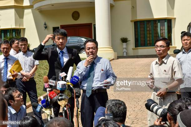 North Korean Embassy counsellor Kim Yu Song gestures while reading a statement to journalists waiting outside the North Korean embassy in Kuala...