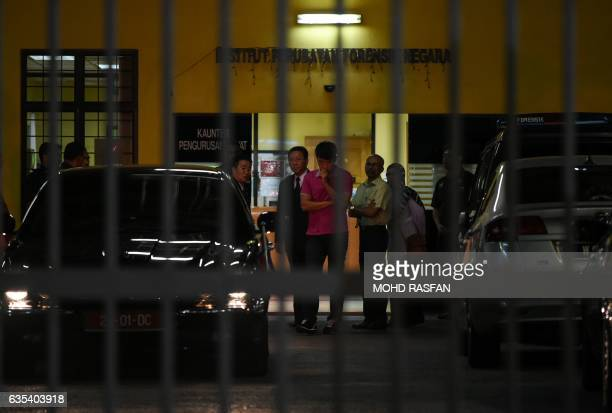North Korean embassy officials leave the Forensic department where the body of a North Korean man suspected to be Kim JongNam halfbrother of North...