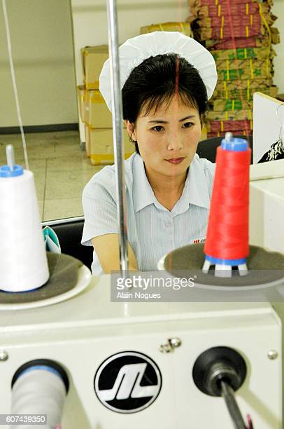 North Korean employees wearing the badge of the ShinWon Ebenezer company 15% of the North Korean clothing industry is produced here The Kaesong...