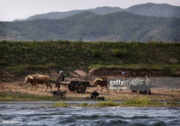North Korean farmers work on the Yalu river north of the border city of Sinuiju North Korea across from Dandong Liaoning province northern China on...