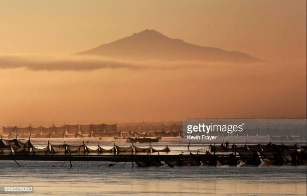 North Korean fishermen are seen at sunrise on the Yalu river in the border city of Dandong Liaoning province northern China across from the city of...
