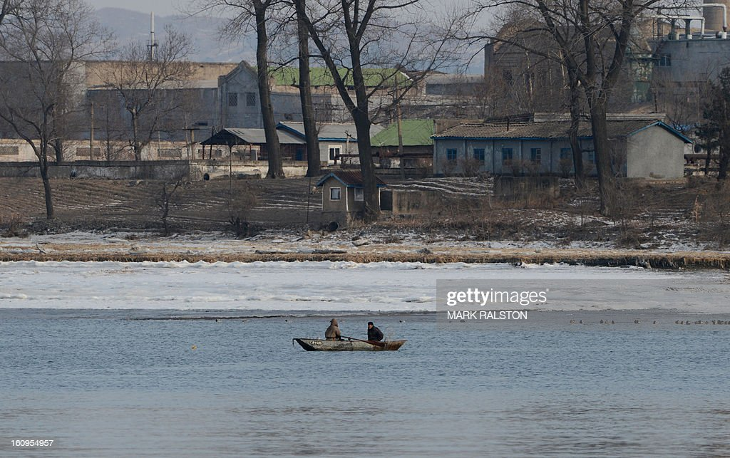 North Korean fishermen paddle on the Yalu River at the North Korean town of Sinuiju on February 8, 2013 which is close to the Chinese city of Dandong. US Secretary of State John Kerry warned that North Korea's expected nuclear tests only increase the risk of conflict and would do nothing to help the country's stricken people. The country has vowed to carry out a third nuclear test soon, and concerns have been raised over the type of fissile material used in the device. AFP PHOTO/Mark RALSTON
