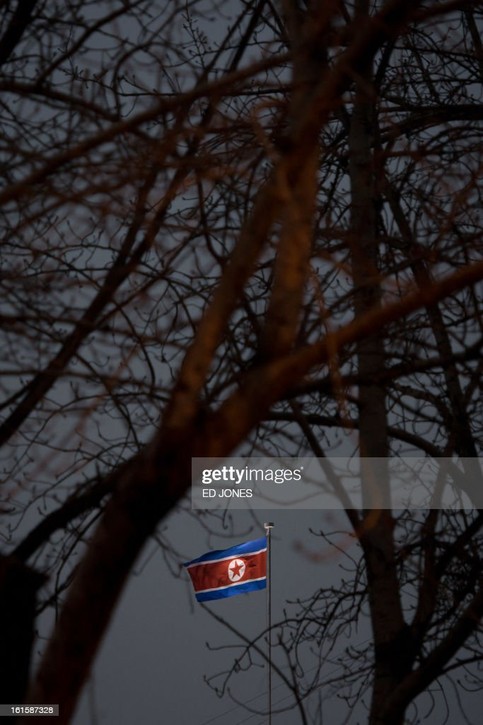 A North Korean flag flies above the North Korean embassy in Beijing on February 12, 2013. North Korea confirmed on February 12 it had 'successfully' carried out an underground nuclear test, drawing immediate condemnation from rival South Korea. AFP PHOTO / Ed Jones