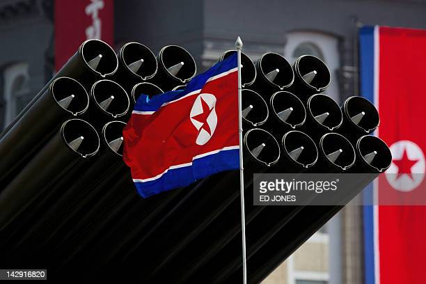 A North Korean flag flies before missiles displayed during a military parade to mark 100 years since the birth of the country's founder Kim IlSung in...