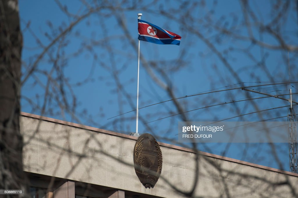 A North Korean flag flutters at the North Korean embassy in Beijing on February 7, 2016. North Korea hailed an 'epochal event' but its latest long-range rocket launch on February 7 prompted international anger and plans for talks on a missile defence system for the peninsula. AFP PHOTO / FRED DUFOUR / AFP / FRED DUFOUR