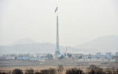 A North Korean flag flutters in the propaganda village of Gijungdong as seen from a South Korean military check point of the truce village of...