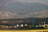 A North Korean flag flutters over North Korea's village of Gijungdong as seen from an observatory point in Paju near the Demilitarized Zone dividing...