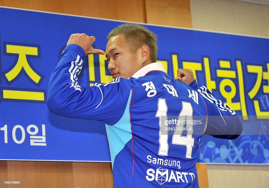 North Korean football striker Jong Tae-Se poses in his Suwon Samsung Bluewing uniform during a press conference for his transfer in Seoul on January 10, 2013. Suwon Samsung Bluewings announced that Jong, who will become the fourth North Korean to play in the K-League, has inked a three-year contract.